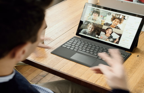 photo of a person with a laptop on a zoom call